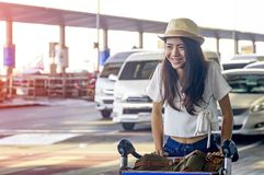 Young woman in airport waiting for air travel using smart phone. Young woman in airport waiting for air travel.Travel Concept Stock Image