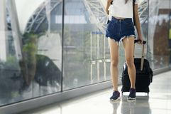 Young woman in airport waiting for air travel using smart phone. Travel Concept Royalty Free Stock Photo