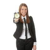 A young woman with alarm clock Royalty Free Stock Image