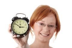 A young woman with alarm clock Stock Photography