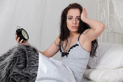 Young woman with alarm clock. Royalty Free Stock Image
