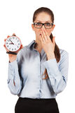 Young woman with an alarm clock in a hand Stock Image