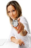 Young woman with alarm clock at the office Royalty Free Stock Image