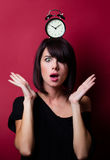 Young woman with alarm clock Stock Image
