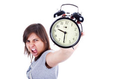 Young woman with alarm clock screaming Royalty Free Stock Image