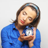 Young woman with alarmclock Royalty Free Stock Photo