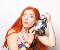 Young woman with alarmclock Royalty Free Stock Photos