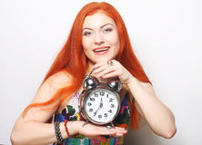 Young woman with alarmclock Stock Image