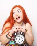 Young woman with alarmclock Stock Photos