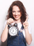 Young woman with alarmclock Stock Photo