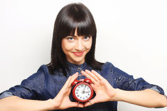 Young woman with alarmclock Royalty Free Stock Images