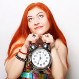 Young woman with alarmclock Stock Images