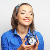 Young woman with alarmclock Royalty Free Stock Image