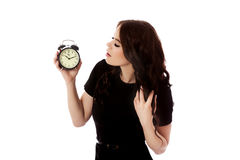 Young woman with alarmclock, isolated. Stock Photography