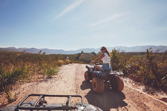Young woman on an all terrain vehicle in nature Stock Photos