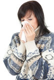 Young woman with allergy or cold with handkerchief Stock Photography