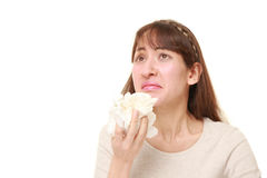Young woman with an allergy sneezing into tissue Stock Image