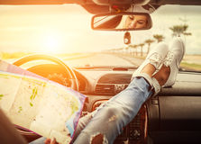 Young woman alone car traveler with map Stock Photo