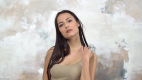 Young woman alone isolated on white in shirt posing sensual stock footage