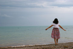 A young woman alone at the seaside Stock Photography