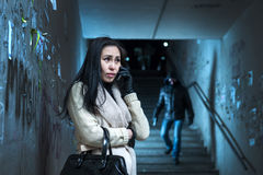 Young woman along at night at a danger. Asian women asks for help over the phone royalty free stock photography