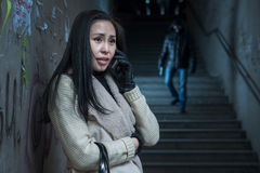 Young woman along at night at a danger. Asian women asks for help over the phone stock photos