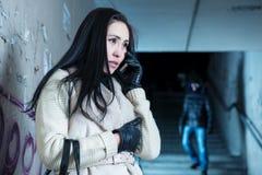 Young woman along at night at a danger Royalty Free Stock Image