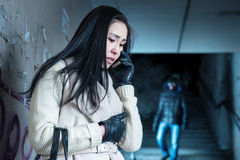 Young woman along at night at a danger. Asian women asks for help over the phone royalty free stock image