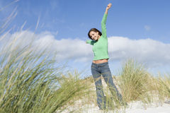 Young woman amongst dunes Stock Photo