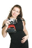 Young woman with ancient camera Stock Image