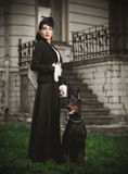 Young woman in ancient costume with dog (ancient ver) Stock Image