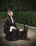 Young woman in ancient costume with dog (ancient ver). Young woman in ancient costume with dog (ancient version Royalty Free Stock Photo