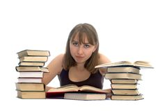 Young Woman And A Pile Of Books Royalty Free Stock Photos