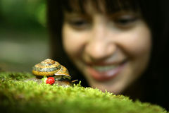 Young Woman And Snail Stock Photos