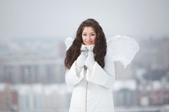 Young woman with angel wings Royalty Free Stock Photos