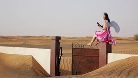 Young woman with angel wings in a desert stock video footage