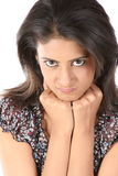 Young woman with an angry expression Stock Image