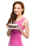Young woman with anniversary cake Royalty Free Stock Photo