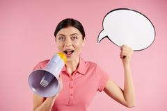 Young woman announces into megaphone royalty free stock photo