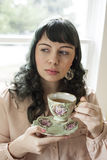 Young Woman with Antique Tea Cup Stock Image