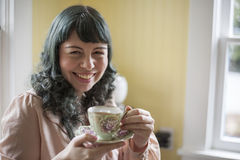 Young Woman with Antique Tea Cup Royalty Free Stock Photo