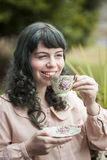 Young Woman with Antique Tea Cup Stock Photography