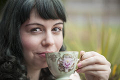 Young Woman with Antique Tea Cup Royalty Free Stock Photography