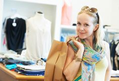 Young woman at apparel clothes shopping. Woman buyer with apparel purchase during garments clothing shopping at clothes store stock images
