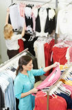 Young woman at apparel shopping Royalty Free Stock Images