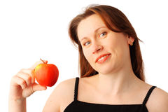 Young woman with an apple Royalty Free Stock Photography