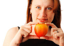 Young woman with an apple. Closeup portrait of a young pretty woman holding a red apple in her hand, isolated over white background Stock Image