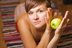 Young woman with apple Royalty Free Stock Images