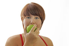Young woman with apple Stock Photography