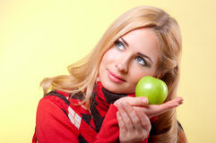 Young woman with apple Royalty Free Stock Image